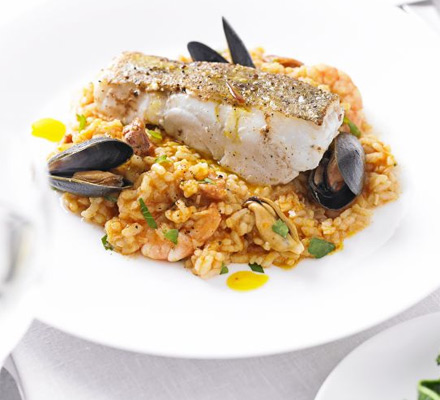 Roast cod with paella and saffron olive oil